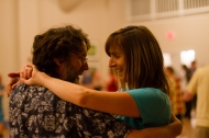 A pair smile on the dance floor. Photo by Sam Whited, used here under Creative Commons license with thanks.