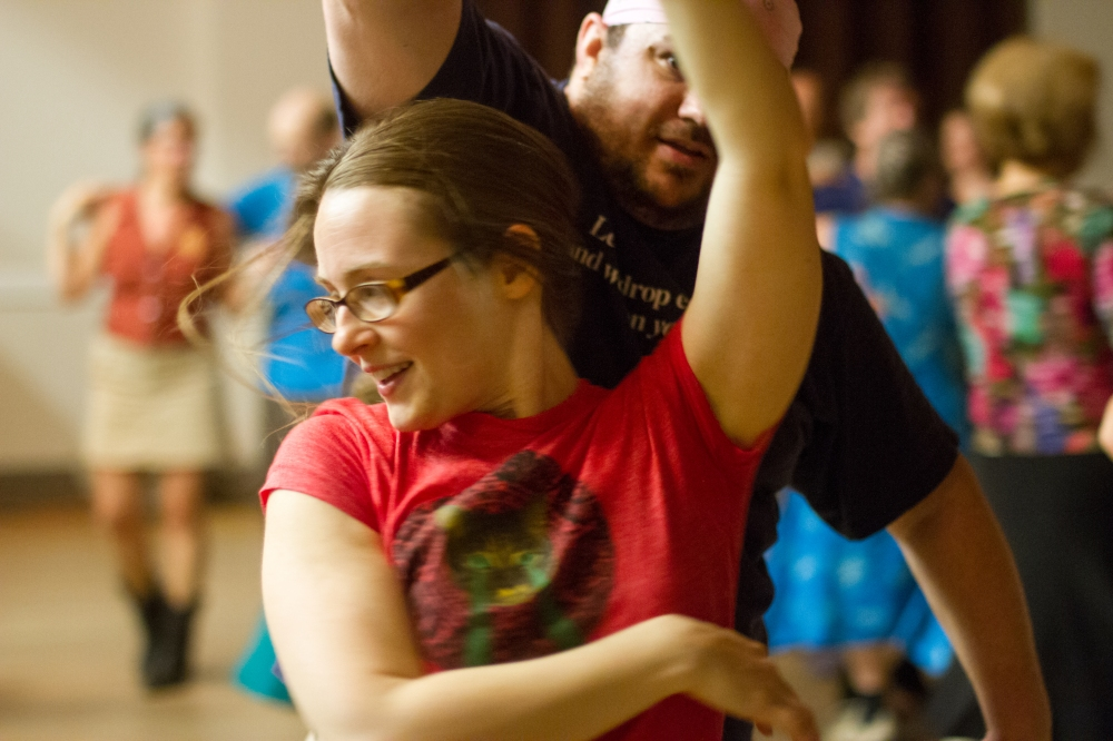 A couple turns in a contradance. Photo by Sam Whited, used here under Creative Commons license with thanks.
